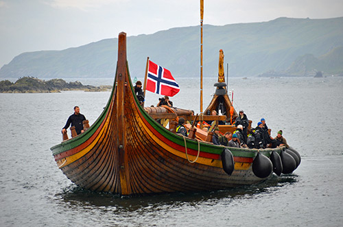 Picture of a viking ship replica arriving in a harbour
