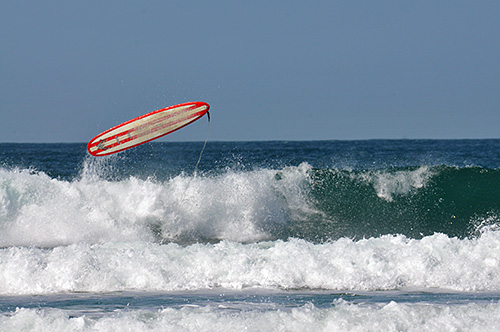 Picture of a surfboard thrown into the air after the surfer fell off