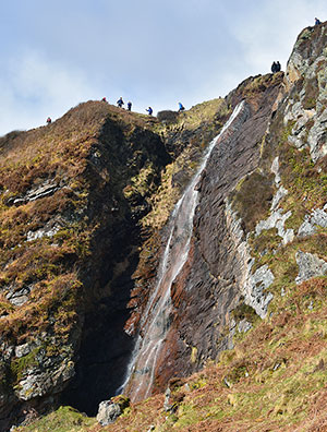 Picture of walkers above a waterfall