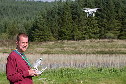 Picture of Armin Grewe flying a DJI Phantom 3 quadcopter