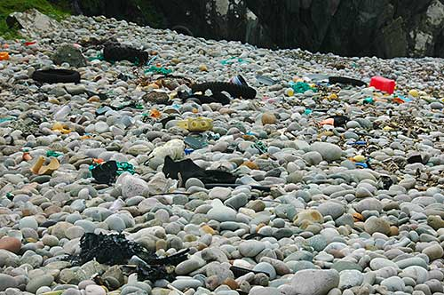 Picture of various rubbish on a pebble beach